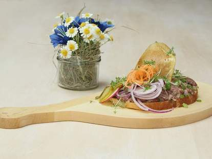 wooden paddle with food on it
