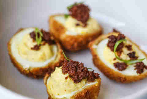 chorizo topped fried deviled eggs school house pub austin
