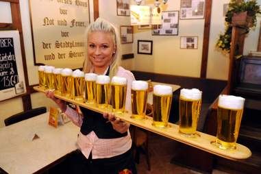 Woman holding a lot of beers