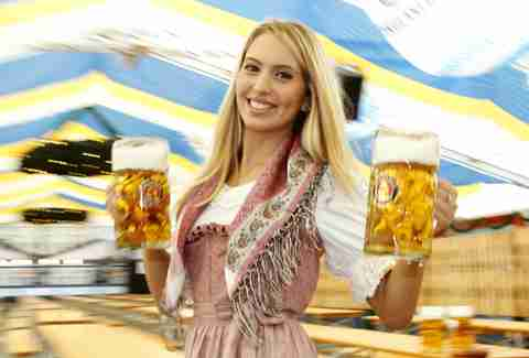 Pretty lady holding beers