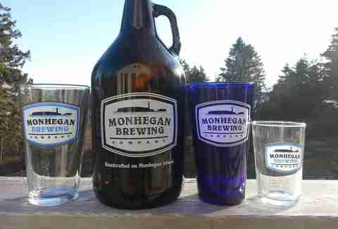 Growler and pint glasses from Monhegan Brewing Company