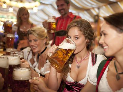 women drink beer at oktoberfest