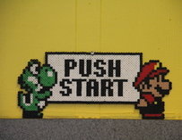 "Yoshi and Mario with a ""Push Start"" button"
