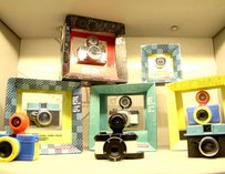 Cameras displayed in colorful cubbies.