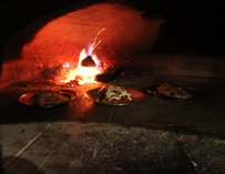 Pizzas being cooked