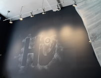 "A chalkboard sign that reads ""HU"""