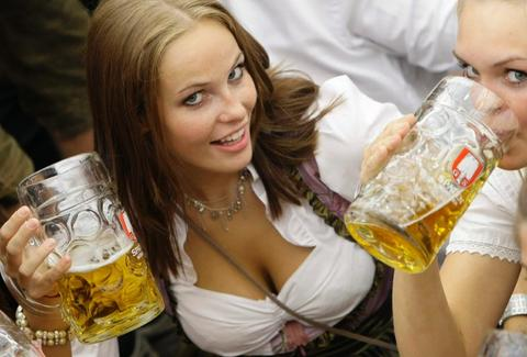 Bierfrau drinking steins at Oktoberfest