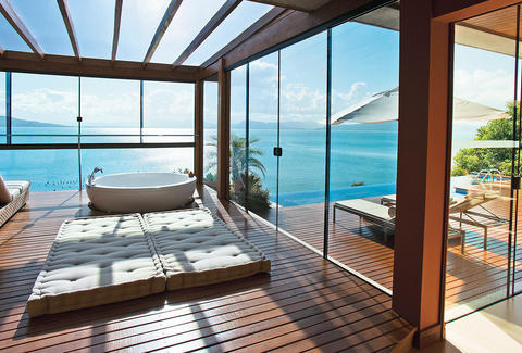 Bathroom with skylight and glass walls overlooking the water