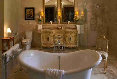 standing bath with ornate counter