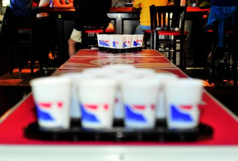 Winning beer pong the 7 secrets to dominating beer pong thrillist beer pong rack solutioingenieria Images