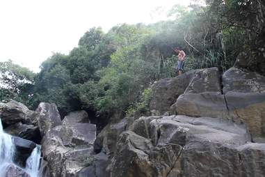 Dude standing at the top of a cliff