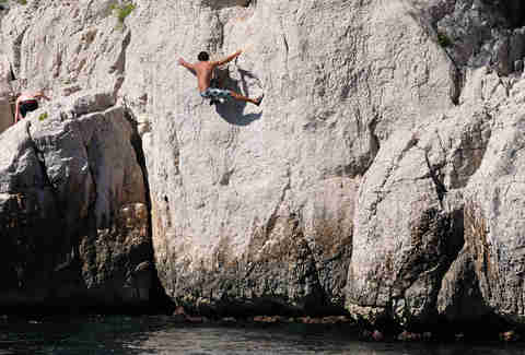 Dude climbing a rock face